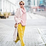 With a Pink Jumper, Yellow Velvet Trousers, and a Light Pink Coat