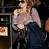 Lauren Conrad made her way to her gate at the Los Angeles airport in a Rag & Bone knit sweater and sunglasses.