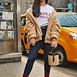 On Assistant Editor Nikita Ramsinghani: I.Am.Gia. coat, Ksenia Schnaider t-shirt, Good American jeans, Stuart Weitzman boots, and LPA bag.