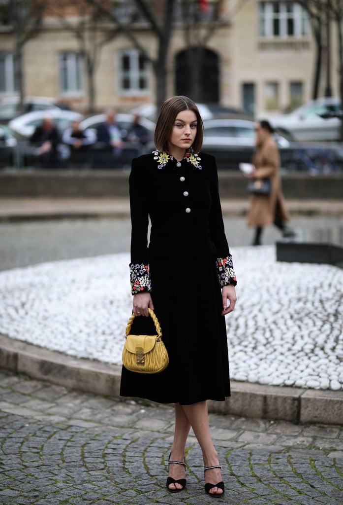 Emma Corrin Wears a Black Miu Miu Midi Dress