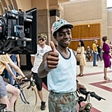 Caleb McLaughlin, in character as Lucas, flashes a thumbs up.