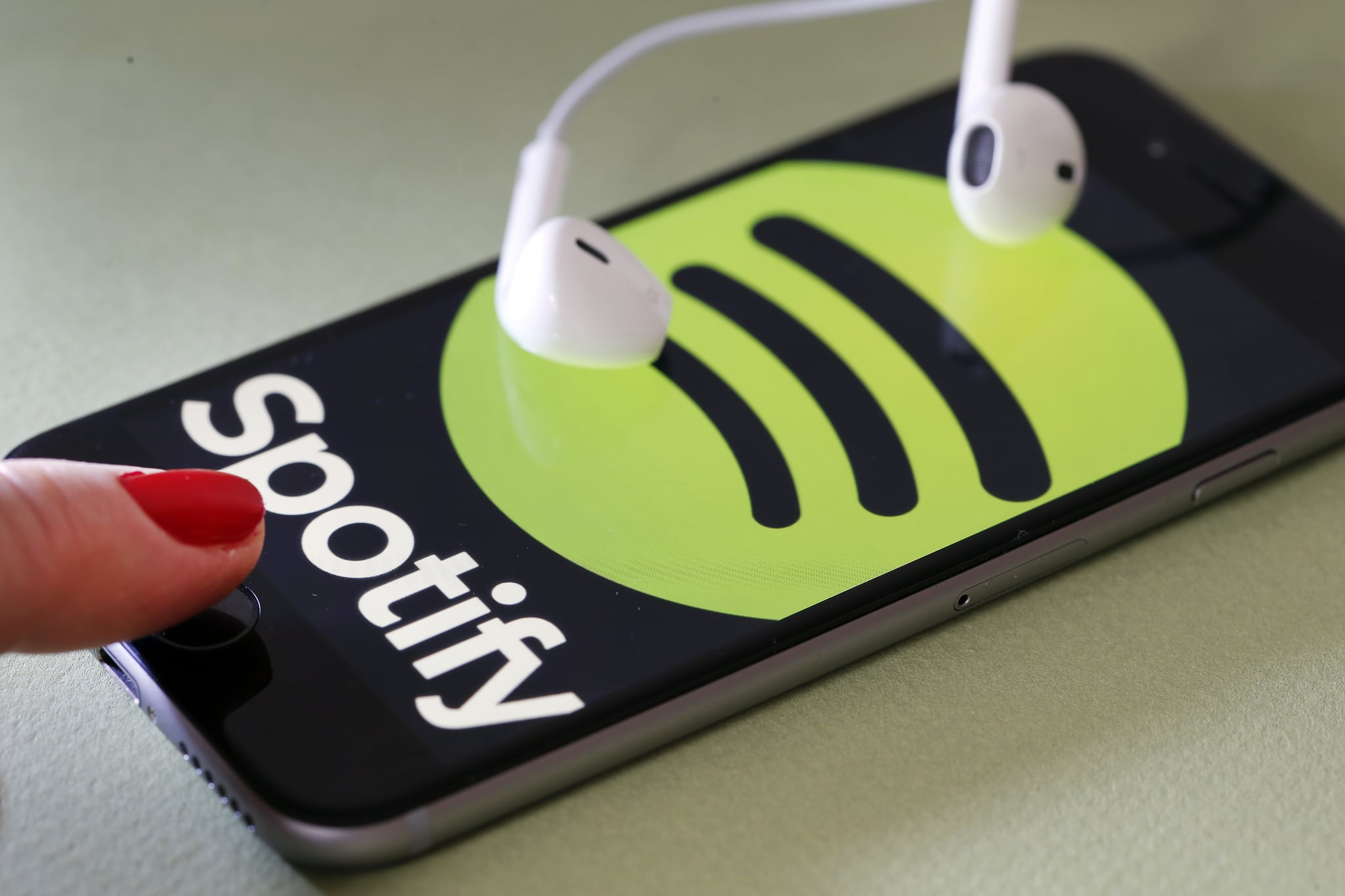 PARIS, FRANCE - JANUARY 06:  In this photo illustration, the logo of the Swedish music streaming service Spotify is displayed on the screen of an iPhone on January 06, 2017 in Paris, France. Spotify announced, via a tweet published Thursday, that it now has 70 million paid subscribers. As a comparison, in September, Apple Music claimed 30 million subscribers and Deezer had fewer than 10 million subscribers. Spotify, the world's largest streaming music company, is expected to be listed on the Wall Street stock market in the first quarter of 2018.  (Photo by Chesnot/Getty Images)