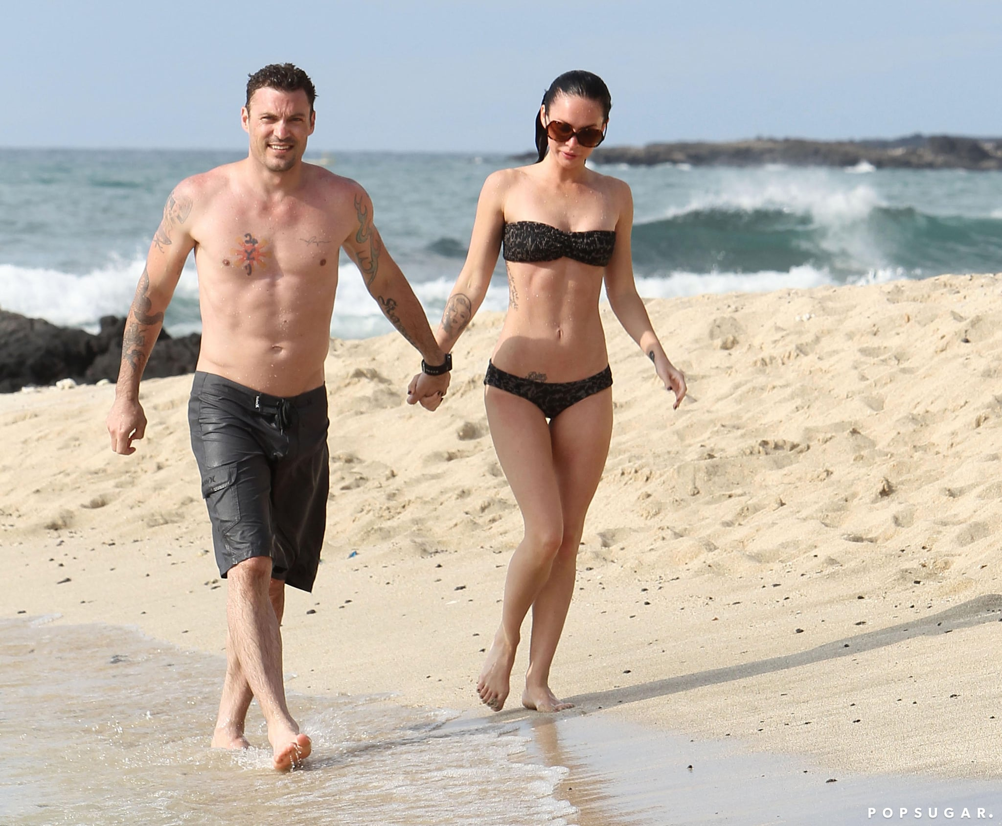 The couple held hands on the beach as they relaxed in Hawaii in June 2010.