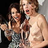 Selena Gomez and Taylor Swift posed backstage with their respective awards in 2011.