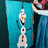 "Playing on the character's tendency to misplace his nose, Anna had the party guests play a game called ""Pin the Nose on Olaf."" Thanks to Etsy, you can get your hands on this kid-friendly game ($25) also."