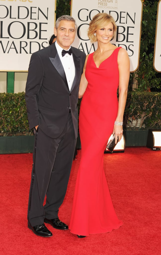 George Clooney hit the Golden Globes red carpet today with his girlfriend Stacy Keibler. Stacy and George have been enjoying the fun of a busy awards season so far. They've got their posing routine down pat after stops at the Palm Springs gala, the National Board of Review's awards, and the Critics' Choice last week. Today, George is up for four awards. It's one of the biggest evenings of the year for him, and George even had a say in what Stacy wore! George gave his approval to Stacy's long Valentino dress. Things could get even better for Stacy if she gets a shout-out in one of George's acceptance speeches if he wins!