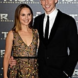 Natalie Portman and Tom Hiddleston smiled for the cameras at the Paris premiere of Thor: The Dark World on Wednesday.
