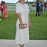 For the Cartier Queen's Cup polo final in 2017, Kitty wore a white midi dress with a box clutch and blue heels.