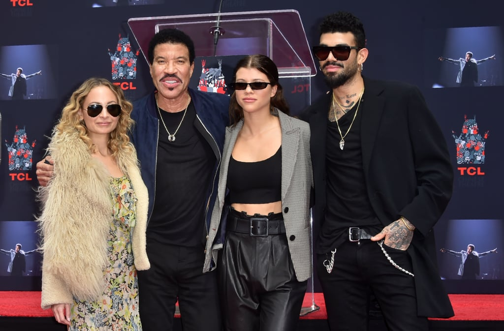 "Lionel Richie's family stepped out in full force to support him at his (long overdue) hand and footprint ceremony in Hollywood on Wednesday. Lionel, who is best known for hits like ""Hello,"" ""All Night Long,"" and ""Say You, Say Me,"" had the support of his three kids, Nicole, 36, Miles, 23, and Sofia, 19, as well as ex-wife Brenda Richie, son-in-law Joel Madden, and girlfriend Lisa Parisi. To make matters even more exciting, Jimmy Kimmel, Samuel L. Jackson, and Brian Grazer all honored their pal by giving heartfelt speeches. Naturally, Nicole and Sofia both documented the special milestone on their Instagram stories, sharing videos of Lionel and poking fun at his poses. Serious question: have you ever seen a cooler family?"