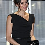 "Clearly a fan of Gucci accessories, Meghan coordinated this ""Jackie O"" Black Halo dress with an elegant bag from the Milan based fashion house. She was attending the Women's Empowerment Reception in London in April 2018, right before her wedding."