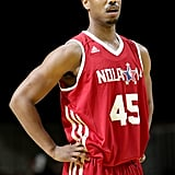 His arms were on display in a basketball jersey during the NBA All-Star Celebrity Game in New Orleans in February 2014.