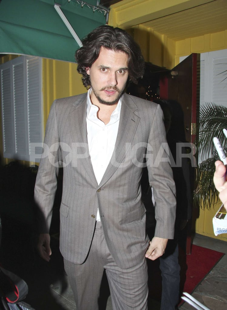 """John Mayer was spotted looking dapper in a gray suit leaving dinner at Dan Tanas in West Hollywood last night. He's been on a digital cleanse since wrapping up his Battle Studios shows and quitting Twitter in the Fall, though he jumped back into our online lives over the holidays chronicling a seven-day road trip with friends they jokingly billed as """"TourLoko."""" The group of six guys, including The Office's BJ Novak, followed the Philadelphia 76ers from San Francisco to Phoenix with a brief stop in Palm Springs. Blogging and tweeting accounts of their every move gave fans an all-access pass to John's final days of the year. The last stop on the """"tour"""" brought John and the guys to Las Vegas where he joined Jay-Z and Coldplay on stage for a performance. We'll see John back on stage next month at the Grammy Awards where he's nominated for three awards including best pop album."""