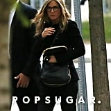 Jennifer Aniston wore a pair of glasses as she headed into a building in Boston.