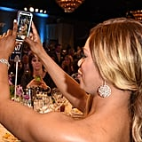 Orange Is the New Black actress Laverne Cox snaps a selfie at the 25th Annual GLAAD Media Awards in April 2014.