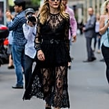 Olivia belted her sheer Elie Saab dress and completed the look with pointy flats during Couture Week in Paris in 2016.