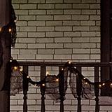 Black Lighted Garland With Orange Lights