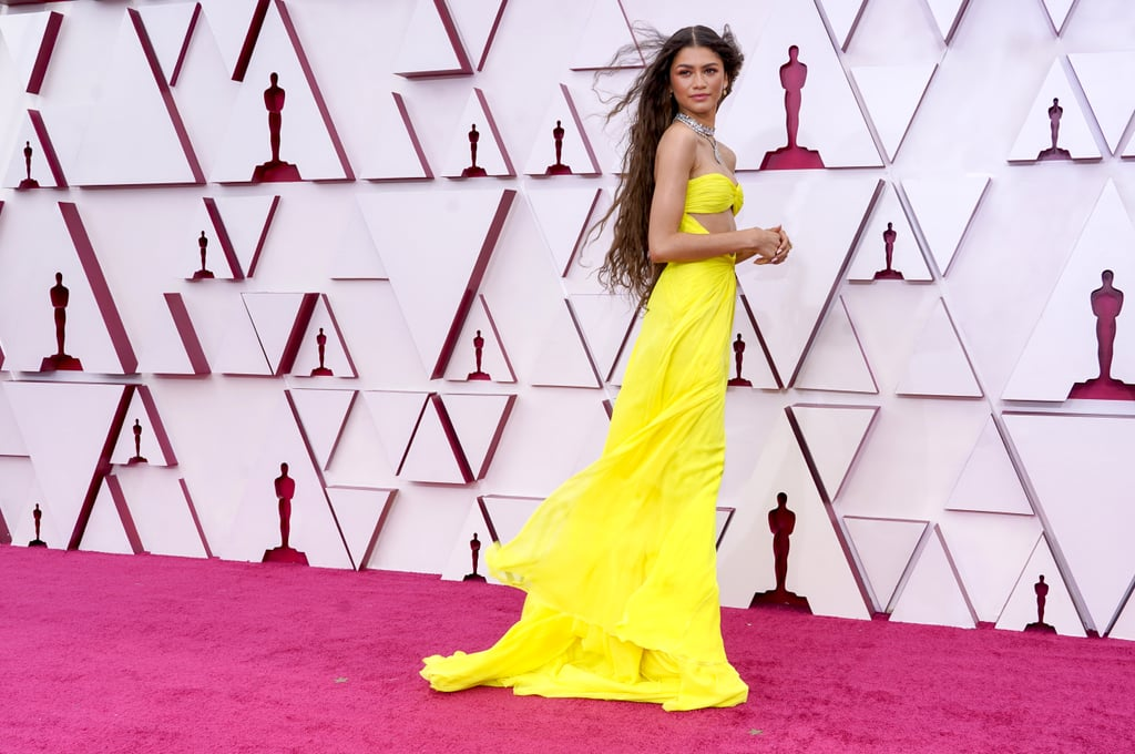 Can we all just take a moment to appreciate the greatness that is Zendaya at the Oscars? On Sunday night, the 24-year-old showed up on the red carpet looking like an actual ray of sunshine, and we just can't turn our eyes away. Wearing a flowing yellow dress (that glows in the dark, BTW) and a diamond necklace, Zendaya gave the camera all the angles as she struck a pose and let the LA breeze do the rest. While the actress didn't score a nomination for her incredible role in Malcolm & Marie this year, these photos prove she's still the true winner of the night. See more photos of her stunning appearance ahead.       Related:                                                                                                           BRB, We're Replaying Zendaya's Adorable Reaction to H.E.R.'s Oscar Win