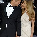 Brad Pitt and Jennifer Aniston shared a sweet glance at the premiere of Troy  in 2004.