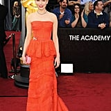 Michelle Williams's gown had a small gold bow at the right hip.