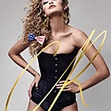 Gigi Hadid wearing a corset and underwear by What Katie Did and custom earrings by Melody Ehsani.