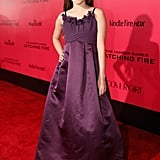 Young Erika Bierman, aka President Snow's granddaughter, went with a purple gown.