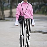 Stripy Trousers and a Pink Jumper Worn Over a White Shirt