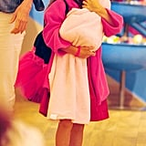 Suri Cruise held her baby-doll in a pink blanket.