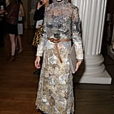 Olivia made her gorgeously textured, ethereal dress feel a little less fancy by adding a knotted tan belt.
