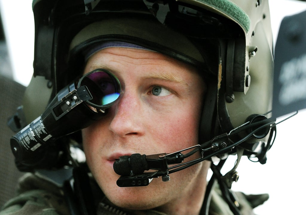 Prince Harry sat in his helicopter in Afghanistan.