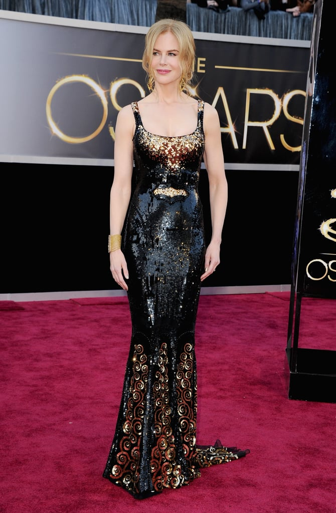 Nicole Kidman made a dramatic choice this evening, wearing a L'Wren Scott gown to the Oscars. She's been a familiar face on red carpets this award season. She was nominated — but did not win — for her work in The Paperboy and Hemingway & Gellhorn at the SAG Awards and the Golden Globes. Nicole also trekked to her native Australia for their AACTA Awards. It hasn't been all about Nicole and her work, though, as she also accompanied her musician husband, Keith Urban, to the Grammys. Most recently, Nicole was in London for the UK premiere of her latest film, Stoker. All the jet-setting is on hold for tonight, as Nicole preps to present at the Oscars. While not in the running for her films in 2013, she did memorably win in 2003 for The Hours. Weigh in on Nicole's look in our Oscars red-carpet fashion and beauty polls.
