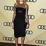 Kate Bosworth was the picture of cool in an Emilio Pucci black dress. What we love most, though, is that Kate never veers into boring LBD territory; instead, the knee-length number features sexier sheer overlays and shoulder cutouts. To finish off the look, she accessorized with a black python clutch and black pumps.