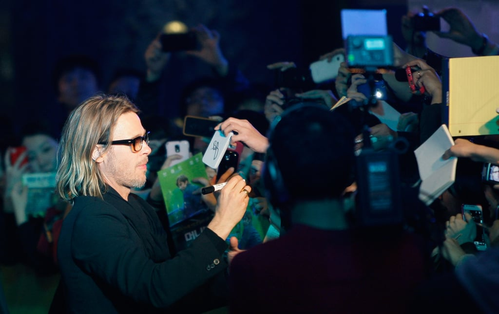 Brad Pitt signed autographs before the screening.