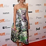 "Keira Knightley got feminine in a floral strapless fit-and-flare Mary Katrantzou dress and nude ankle-strap pumps at the Can a Song Save Your Life?"" premiere at the Toronto Film Festival."