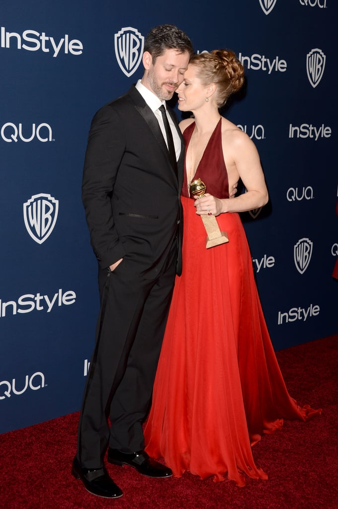 Amy held on to Darren — and her Golden Globe — at a 2014 afterparty hosted by InStyle and Warner Bros.