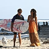 Camila headed to the beach in Malibu while Matthew surfed in May 2009.