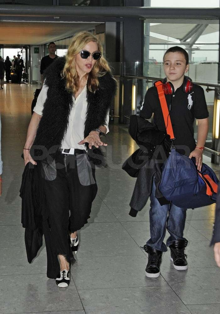 Madonna with Rocco Ritchie at Heathrow.