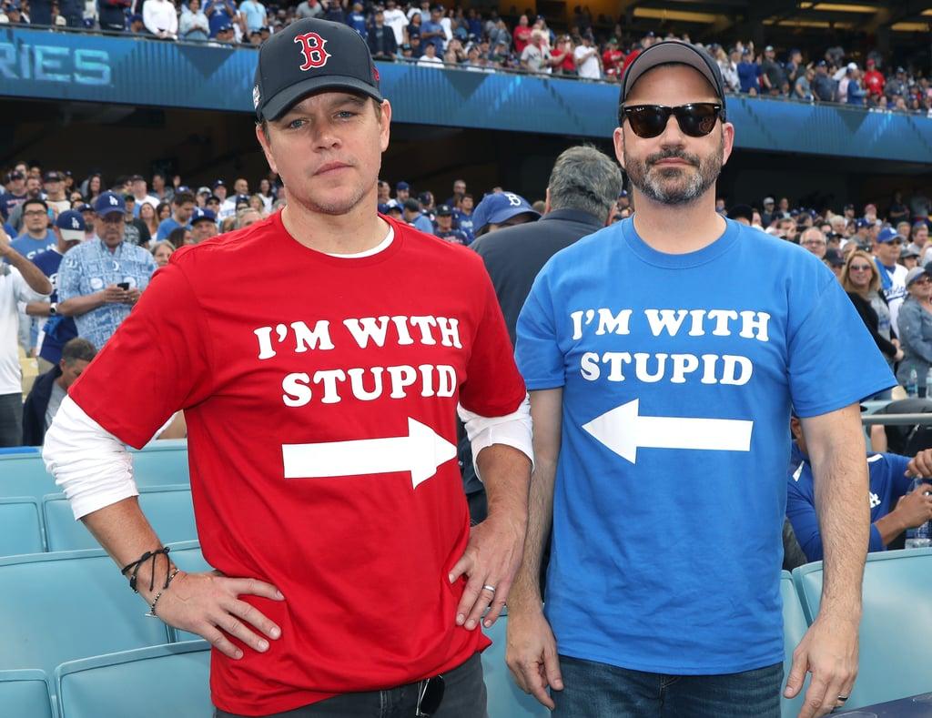 """استعرض النّجم مات ديمون ومقدّم البرامج الشهير جيمي كيميل خصامهما بطريقة مرحة أثناء حضورهما كأس البيسبول العالميّ يوم الأحد الفائت هذا. حيث ظهر الصديقان، اللّذان لا يتوقفان عن مضايقة بعضهما منذ زمن، وهما يرتديان قميصين عليهما عبارة """"أنا برفقة غبيّ"""" خلال تشجيعهما لفريقيهما المفضّلين. إذ ارتدى مات قميصاً أحمراً دعماً لفريق Boston Red Sox، وارتدى جيمي قميصاً أزرقاً لدعم فريق Los Angeles Dodgers. وبينما التقط الاثنان صورة تجمعهما معاً قبل المباراة، إلا أنّهما في نهاية المطاف استخدما صديقهما المشترك بِن أفليك كحاجز لفك العراك بينهما، ممّا جعل سهميهما يشيران إلى ممثّل فيلم Justice League اللّامع ذاك بدلاً منهما. كان ذلك كلّه نوعاً من المزاح طبعاً. فرغم أنّ مات وجيمي يحبّان إظهار """"كراهيّتهما"""" لبعضهما بطرافة، إلا أنّهما في الواقع صديقين حميمين بالفعل. مع ذلك، لا يمكننا أن نكتفي من لحظات مضايقة كلّ منهما للآخر إطلاقاً؛ سواء كان ذلك بمنع جيمي النّجم مات من الظهور في برنامجه، أو قيام مات بمقاطعة جيمي خلال حفل جوائز الإيمي. شاهدوا أحدث ظهورٍ لهما في معرض الصور أدناه."""