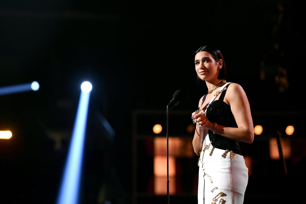 "Before the Grammys cut off Dua Lipa's mic while she was giving her acceptance speech for best new artist on Sunday evening, the ""Swan Song"" singer managed to slip in a subtle dig at Recording Academy president Neil Portnow, who made a sexist remark about female musicians in 2018. Last year's batch of Grammys nominees and winners were made up of almost entirely men, effectively shutting out deserving female artists from the award show. When questioned about the backlash, Portnow told reporters female musicians need to ""step up"" to receive better representation in the industry, a comment which was naturally met with even more criticism. In addition to a group of female executives calling for his resignation, stars like Pink slammed Portnow's statement, saying, ""Women in music don't need to 'step up' — women have been stepping since the beginning of time.""      Related:                                                                                                           Lady Gaga, Drake, Cardi B, and Everyone Else Who Won a Grammy This Year               Now Lipa, who burst onto the music scene with hits like ""New Rules"" and ""IDGAF,"" has joined the chorus of female musicians who want to make sure Portnow knows just how offensive his original comment was to all the hard-working women in the music industry. The 23-year-old British singer began her speech by noting how honored she is ""to be nominated alongside so many incredible female artists this year."" Then she added, ""I guess this year we really stepped up,"" to loud applause and cheers from the audience. Her speech only got more inspirational from there. ""I want to say a really big thank you to the fans, who have allowed me to be the best version of myself,"" she said, before later touching on her own climb to the top. ""For anyone who hasn't realized how special they are to have a different story or background, just know that no matter where you're from, never let that get in the way of your dreams."" Watch her speech in full ahead, as well as seeing some stunning photos from her night at the Grammys.      Related:                                                                                                           50 Dua Lipa Photos That Are, Indeed, Hotter Than Hell"