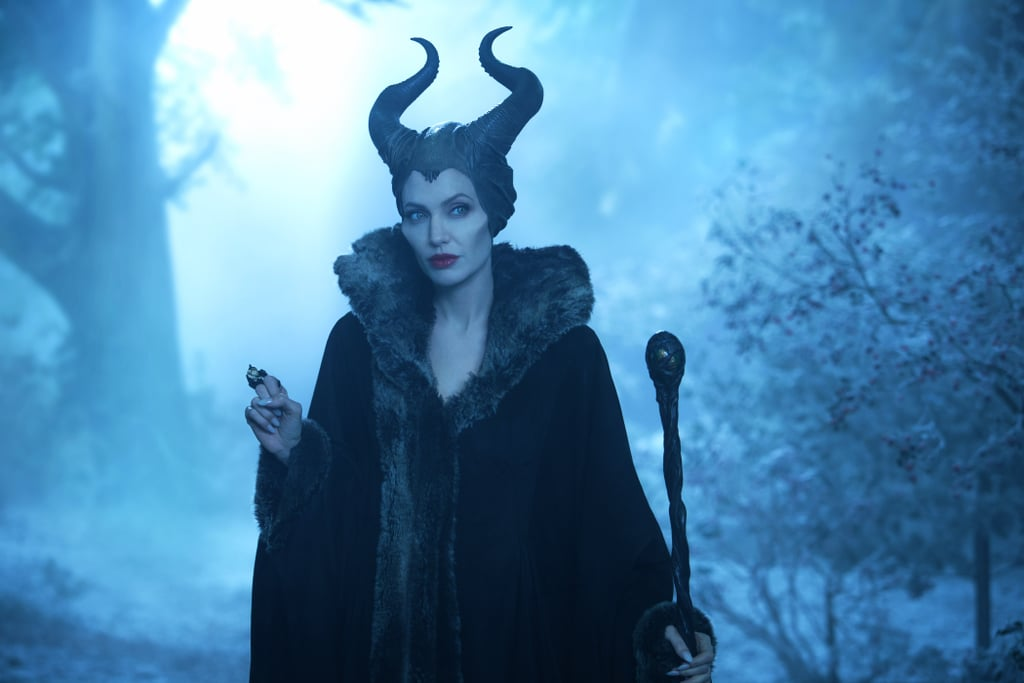 Angelina Jolie makes being bad look so good. Ahead of the release of Maleficent: Mistress of Evil on Oct. 18, Disney has released a behind-the-scenes look at the process of transforming the actress into the Sleeping Beauty villain with cutthroat cheekbones. Just under a minute, the sped-up video is mesmerizing to watch. The process begins fairly simple — Jolie's hair is braided in two pigtails and a smoky eye is applied. Then come the horns, fangs, prosthetic cheekbones, and things get a little more complicated. Meanwhile, Jolie seems completely at ease in the makeup chair as everyone around her pokes and prods. It is her second go at it, after all. Check it out ahead.      Related:                                                                                                           All the Thorny Details We Uncovered About the Sequel to Maleficent