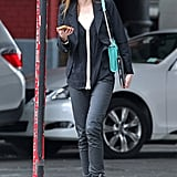 Coco Rocha wore her Monika Chiang sneakers with black jeans, a black-and-white top, black blazer, and a teal Rebecca Minkoff Rivington chain-handle bag out in NYC.