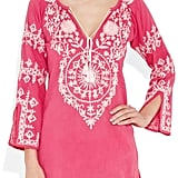 Wear this bold pink embroidered tunic to your next beach resort vacation.  Melissa Odabash Laura Embroidered Cotton Kaftan ($190)
