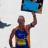 """One runner held up the iconic picture of Boston Marathon bombing victim Martin William Richard with a sign that read, """"No more hurting people. Peace."""""""
