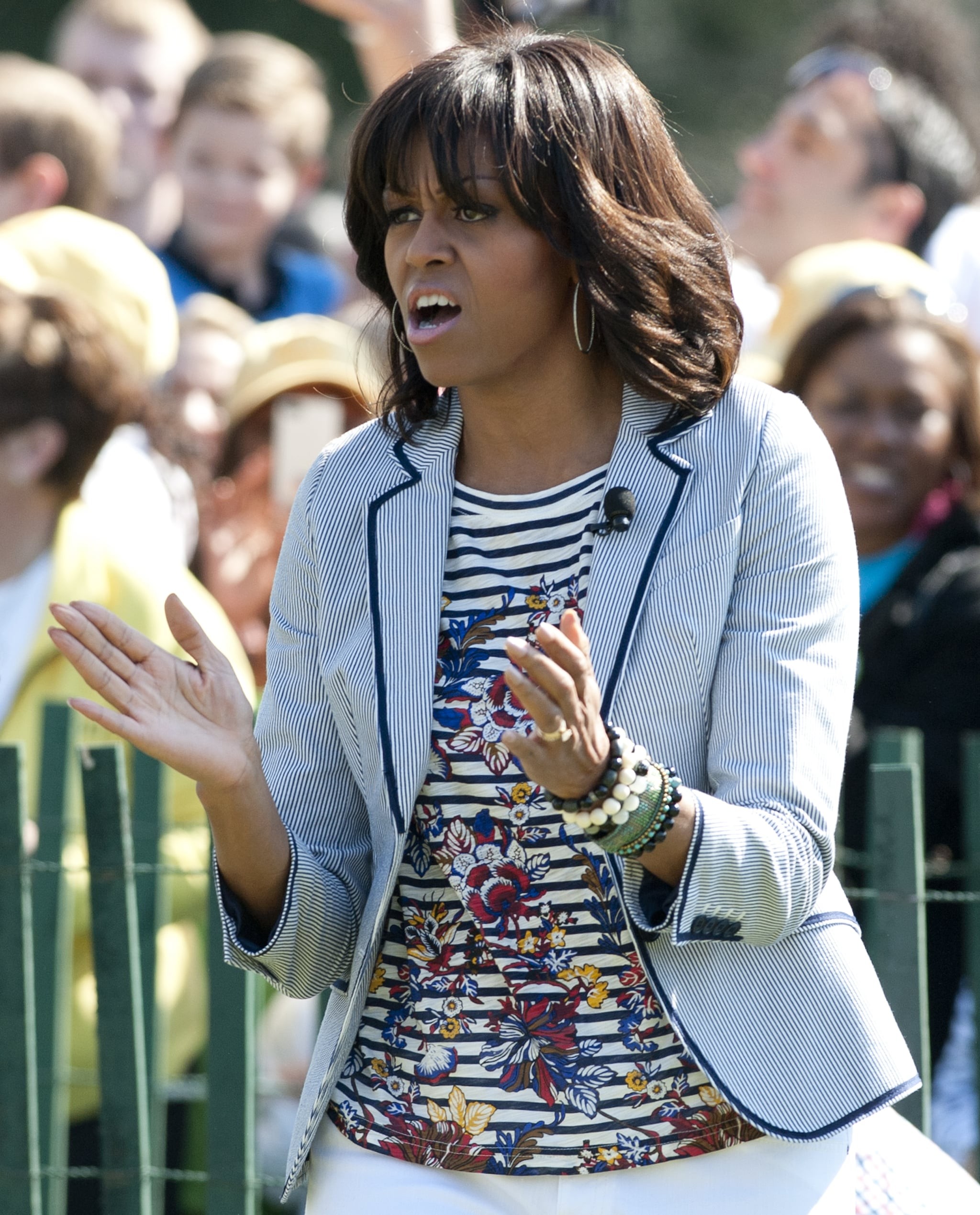 One more look at the cool juxtaposition of her striped floral t-shirt by J.Crew mixed with a seersucker blazer by Talbots.