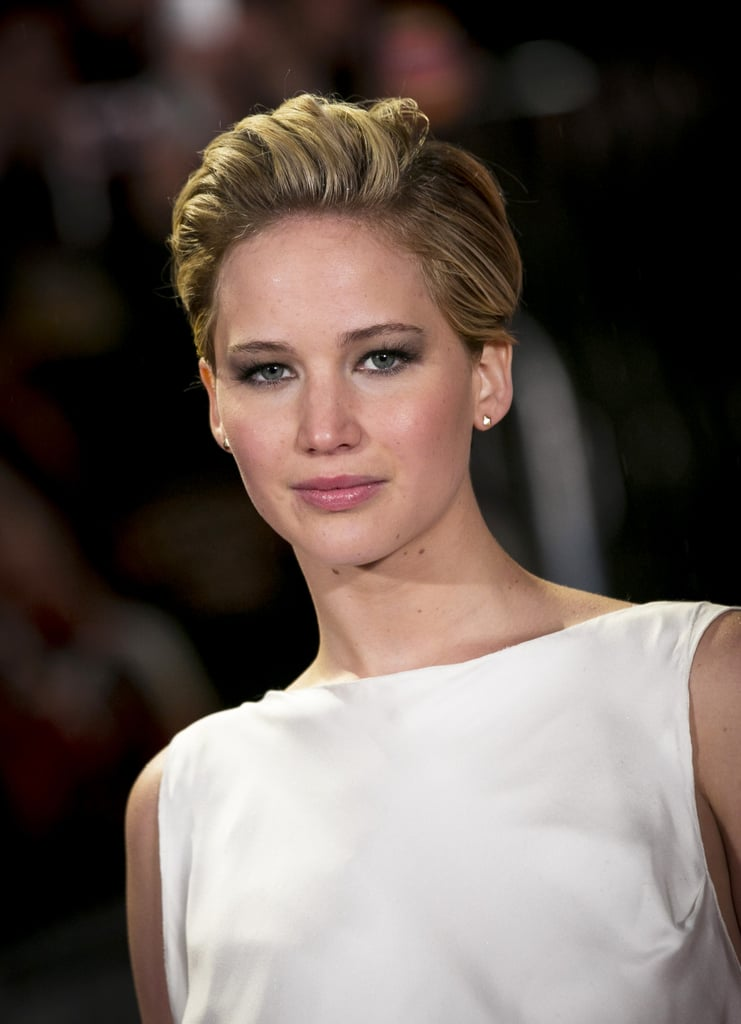 Jennifer Lawrence gave us our first glimpse at her pixie's red carpet capabilities at the Catching Fire world premiere in London.