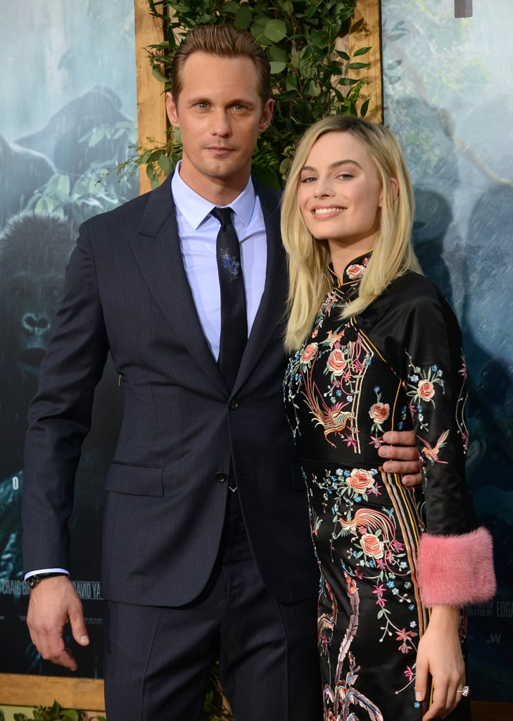 Although Alexander Skarsgard spends much of The Legend of Tarzan shirtless, he hit the red carpet for the movie's LA premiere on Monday covered up in a James Bond-worthy suit. The handsome actor and his costar Margot Robbie flashed bright smiles and broke into laughter while whispering to each other in front of photographers, making quite a picture-perfect pair. The unfairly good-looking duo reportedly had so much chemistry in the film that one of their sex scenes got pretty rough, so we can't wait to see more cute red carpet moments from them in the coming weeks. Keep reading to see more photos of Alexander and Margot!
