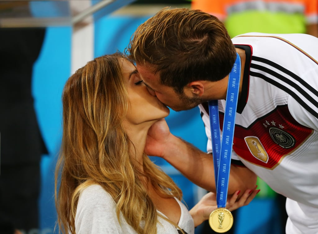 """Germany's Mario Götze scored the only goal of the World Cup final, and it's safe to say he's having a blast celebrating alongside his model girlfriend, Ann-Kathrin Brömmel, and Rihanna. Following his team's big win, 22-year-old Mario gave Ann-Kathrin a big kiss, and as he modelled his brand-new medal, she returned the favour with a kiss on the cheek. The pair later goofed around with his teammate's kids, and they posed for pictures with the World Cup trophy before Mario celebrated with Rihanna — one of the many celebrities at the game. Mario's girlfriend is a 24-year-old lingerie model, and the pair's been linked ever since they were publicly seen together in late 2012. In an interview with GQ Germany, she said, """"I am also the girlfriend of Mario Götze, but I have my own personal goals I want to achieve. Otherwise I could not be more happy."""" And now, of course, she and Mario have plenty to be happy about. On Sunday, the soccer star tweeted a picture of himself with the trophy, writing, """"World Champion 2014! Tastes and feels sooooo good!"""" See the sweet pictures of the couple's celebrations below. Source: Getty / Martin Rose"""