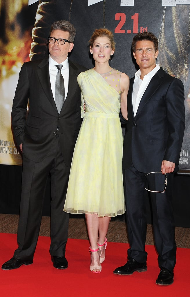 Tom Cruise posed with costar Rosamund Pike and director Christopher McQuarrie.