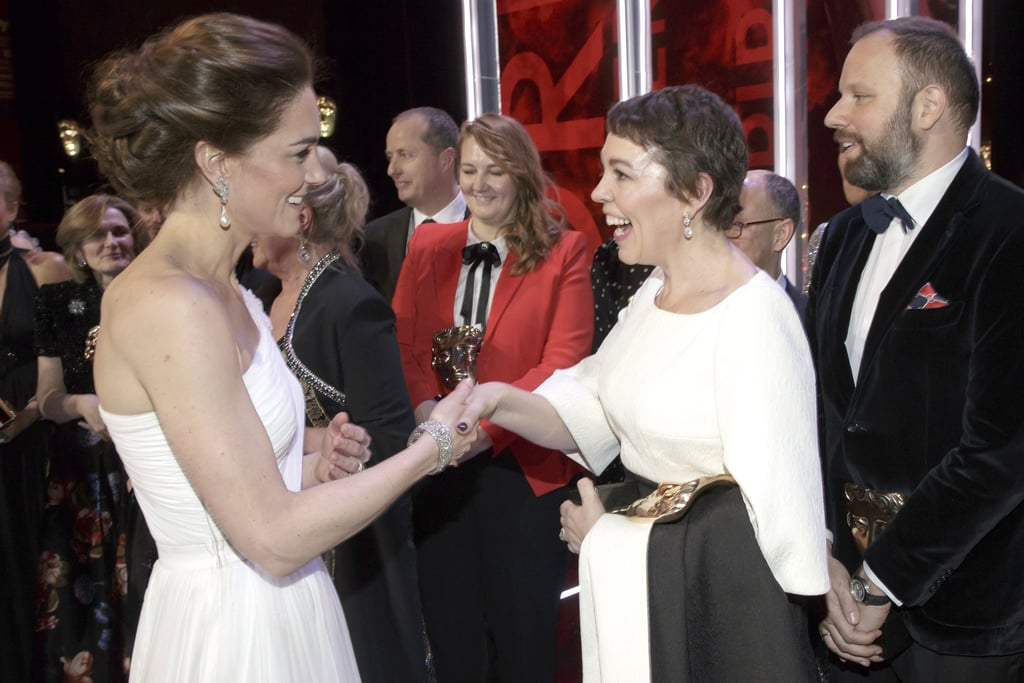Olivia Colman is set to play Queen Elizabeth II on The Crown, but on Sunday night, she mingled with actual royalty at the BAFTAs. Following the ceremony, The Favourite actress shared a cute moment with the show's guests of honor, Prince William and Kate Middleton, as the Duke and Duchess of Cambridge greeted the winners. The British actress looked royally starstruck as she beamed wide during her conversation with Kate and Will. We wonder if the fact that Olivia is playing Will's grandmother came up in conversation.       Related:                                                                                                           40 of the Most Memorable Moments From the 2019 BAFTA Awards