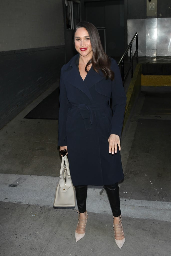 Meghan played up dark Winter outerwear with strappy heels and a neutral leather tote in New York City in March 2016.