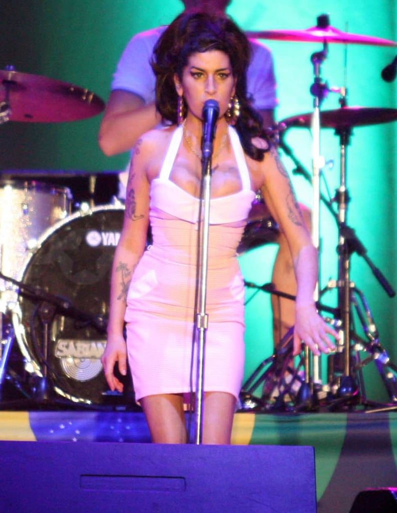 """Amy Winehouse looked fab in a cute gingham dress on stage in Brazil this weekend as she performed her first full show since 2008. She wore her hair up in a high ponytail as she performed some of her most famous hits including """"Back to Black"""" and a few covers too. Amy's reportedly earning £5million for the five date tour, and before she went on stage she was visited at her hotel by Rolling Stone Ronnie Wood, who flew in from Uruguay to see her."""